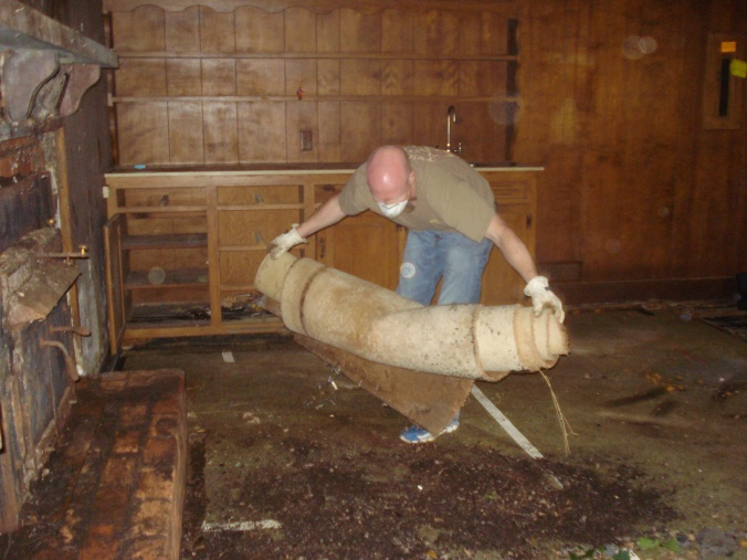 The nastiest job of all... old carpet removal.
