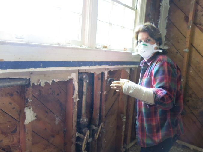 Even though my mom was down a hand, she went to town pulling nails out of the studs. A broken arm can't slow her down!