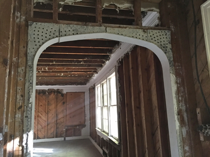 We were able to carefully remove the plaster around the archway from the foyer into the formal living room -- one of the many details we love about our house!