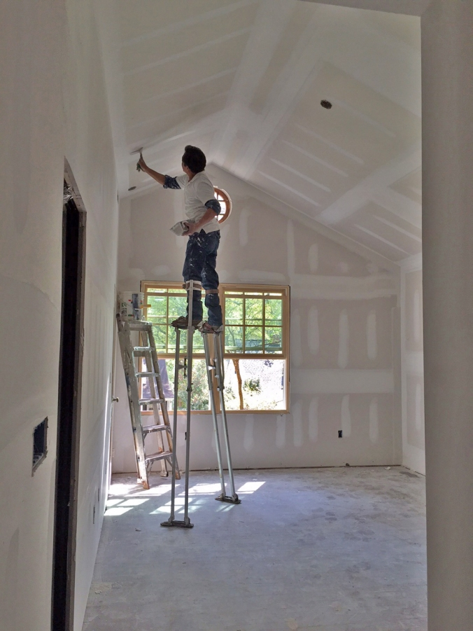 Super stilts to put the finishing touches on the master bedroom!