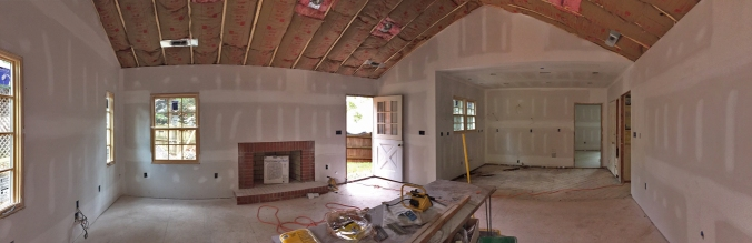 View of great room and kitchen from the back door. Looking good!