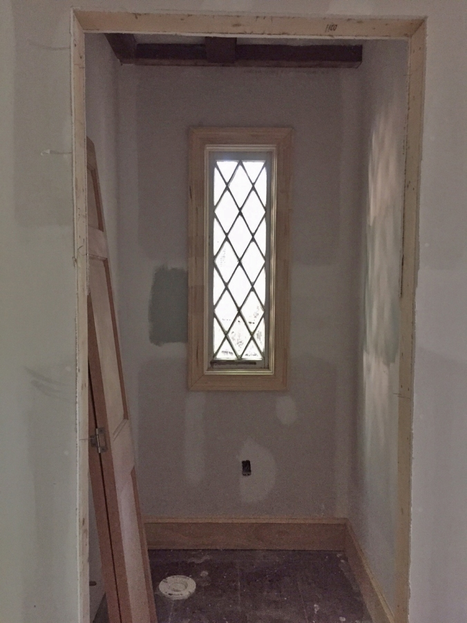 Powder room window is trimmed and looking fantastic...