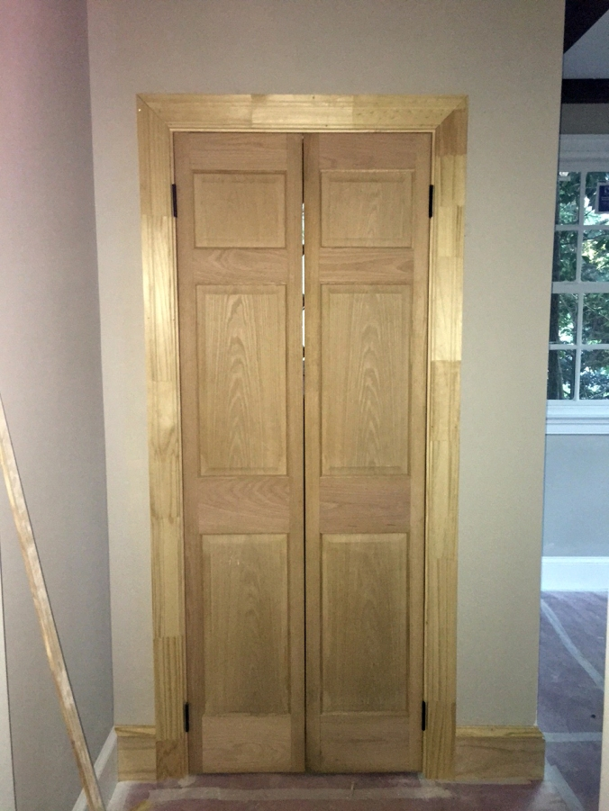 Powder room doors go up.