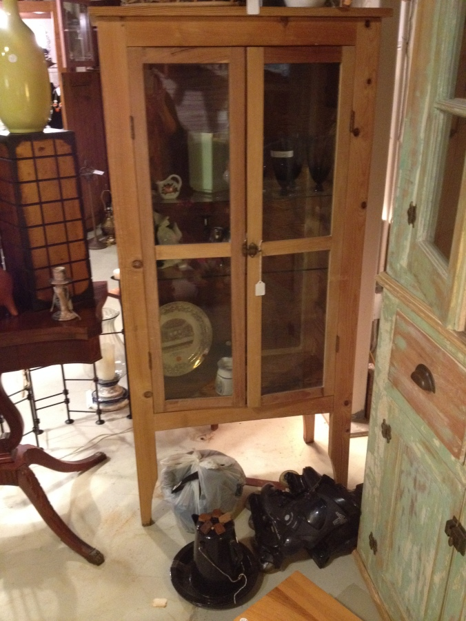 Here's the cabinet! This is the picture my mom sent me from the antique store. It's the only one I have showing the cabinet with the legs still attached.