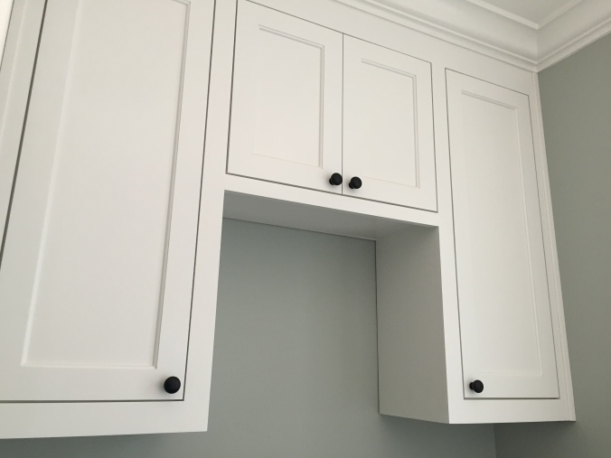 Cabinets over the Washer/Dryer.